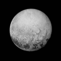 -> New Horizons Photograph of Pluto Shows Surface Features